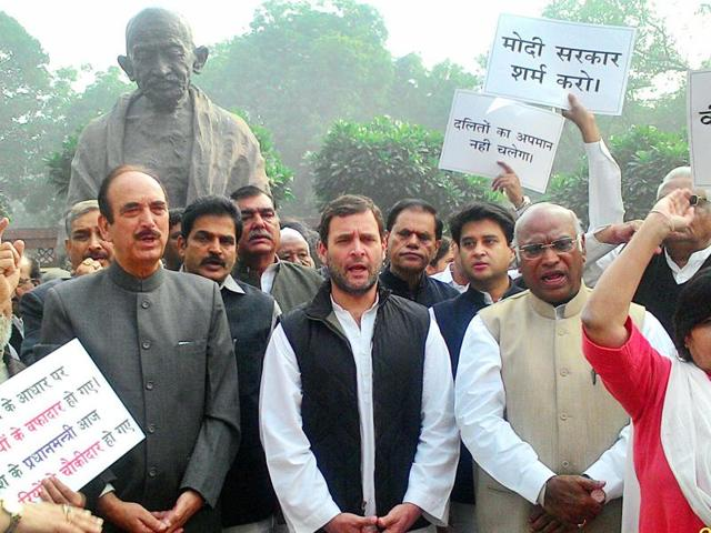 Congress vice president Rahul Gandhi led a protest of Congress MPs outside the Parliament on Monday, December 7, 2015, demanding ouster of Union minister VK Singh over the latter's 'dog remarks'.