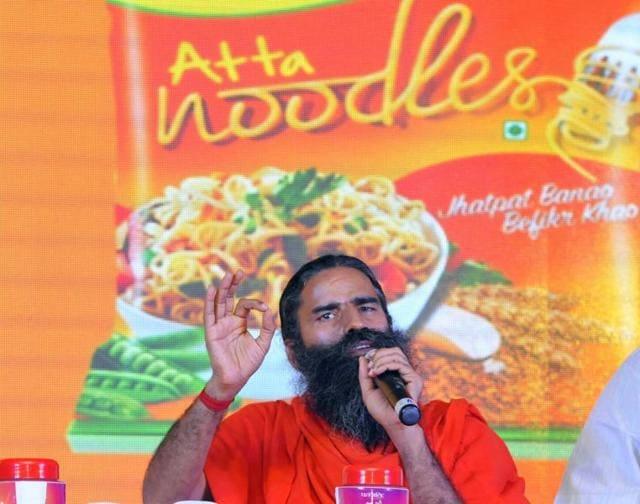 New Delhi, India - November 16, 2015: Baba Ramdev launching Patanjali Atta Noodles, in New Delhi on Monday, 16 November 2015. (Photo by Vipin Kumar/Hindustan Times)