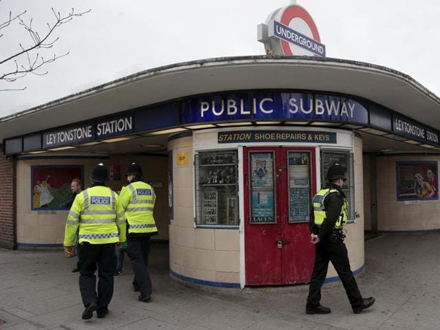 Police officers patrol outside Leytonstone Underground station in east London, Britain December 6, 2015.