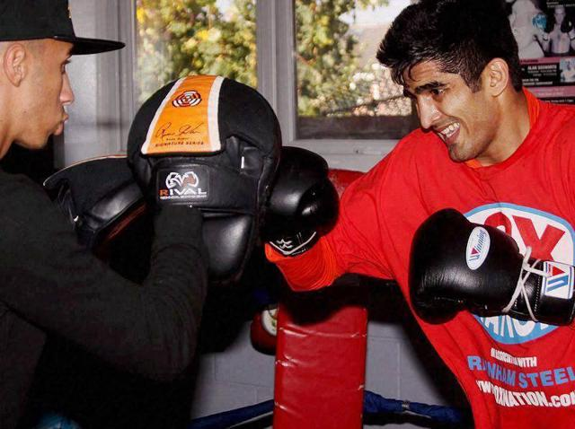 Afile photo of boxer Vijender Singh training at a gym for his second professional bout in Dublin on November 5, 2015.