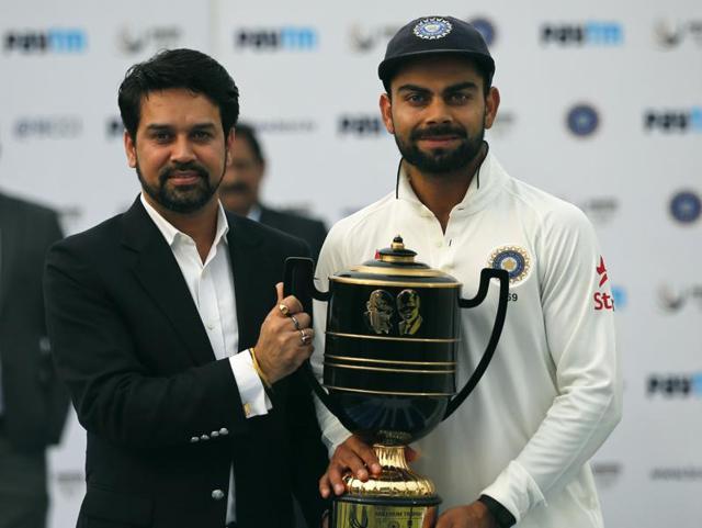 Indian cricket captain Virat Kohli poses with winning trophy after defeating South Africa at Ferozshah Kotla Stadium in New Delhi on December 7, 2015.