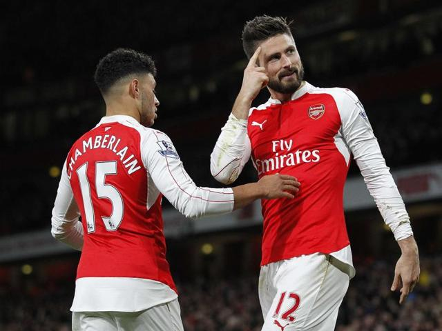 Arsenal's French striker Olivier Giroud celebrates scoring his team's second goal during of the English Premier League football match between Arsenal and Sunderland at the Emirates Stadium in London on December 5, 2015.