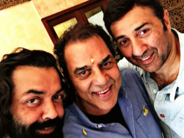 Dharmendra flanked by sons Sunny (r) and Bobby (l). The actor turned 80 on Tuesday.