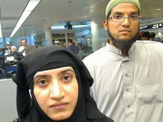 This image obtained from US Customs and Border Protection December 7, 2015 shows Syed Farook and Tashfeen Malik, as they were going through customs in Chicago's O'Hare International Airport on the evening of July 27, 2014.