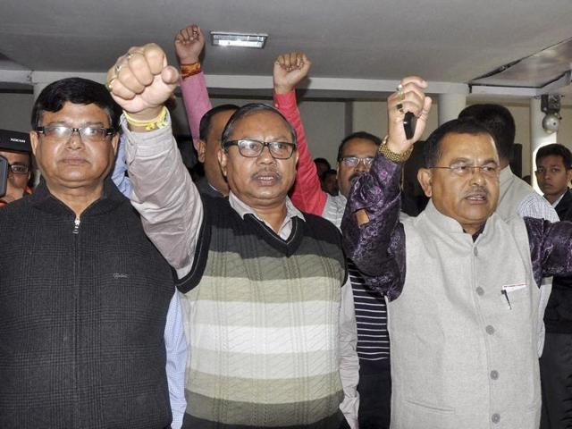 BJP MLAs Jadav Deka (left) and Prasanta Phukan shout slogans as they are pushed out of the Assembly in Guwahati.