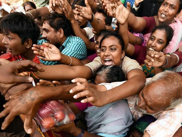 Residents seeking relief materials from volunteers at Kotturpuram, one of the worst flood-hit localities in Chennai .(PTI)