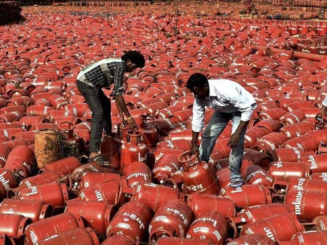 Due to excess rainfall that caused heavy flooding in the city and neighbouring areas, several LPG cylinders kept in a bottling plant at Manali drifted away, in Chennai.(PTI Photo)