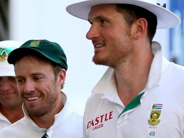 A file photo of South Africa's  AB de Villiers (R) and former skipper Graeme Smith during the second test match against Pakistan in Dubai.