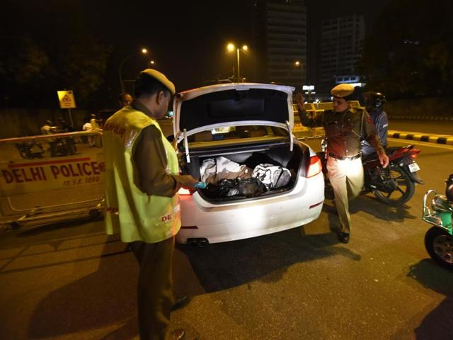 Delhi Police personnel checking vehicles at Barakhamba road as the security has been beefed up.