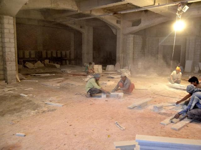 Labourers undertaking construction work in the basement of Golden Temple plaza in Amritsar on Tuesday.