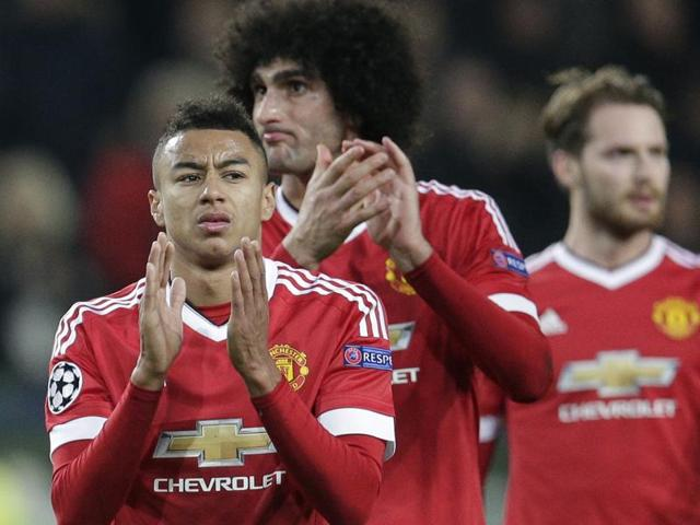 Manchester United players leave the pitch after their team was eliminated from the Champions League by losing 3-2 to Wolfsburg during the Champions League group B match between VfL Wolfsburg and Manchester United on December 8, 2015.
