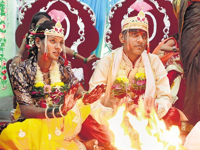 Kishor Mhaske with his bride Kavita on Tuesday.