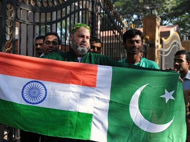 This file photograph shows Mohammed Bashir, a US-based Pakistani cricket fan, holding up the national flags of India and Pakistan.