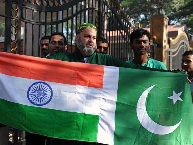 A file photo of Mohammed Bashir, a US-based Pakistani cricket fan, holding up the national flags of India and Pakistan on the eve of the two countries' cricket series in Bangalore.