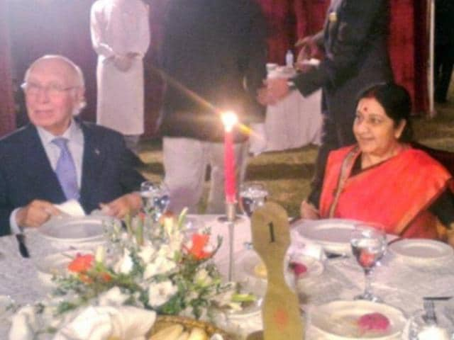Pakistan's Foreign Affairs Advisor Sartaj Aziz (R) greets Indian Foreign Minister Sushma Swaraj on December 8, 2015 in Islamabad. The two are slated to hold talks on  December 9 on the sidelines of a regional meet on Afghanistan, being held in Pakistan.