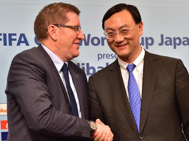 FIFA marketing director Thierry Weil shakes hands with Zhang Dazhong, CEO of Alibaba Sports Group, as they announce that Alibaba E-Auto will help sponsor the Club World Cup football tournament in Tokyo on December 9, 2015.