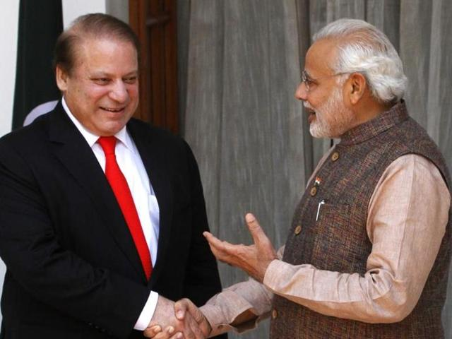File photo of Indian Prime Minister Narendra Modi interacts with Pakistan Prime Minister Nawaz Sharif, left, before a meeting in New Delhi. A Pakistani media report has said that Modi will visit Pakistan in 2017 for the SAARC summit.