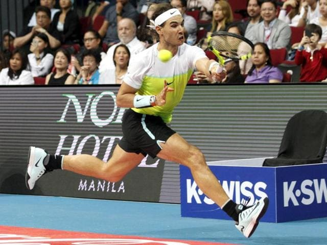 Indian Aces player Rafael Nadal plays against Manila Mavericks player Milos Raonic during their men's singles match in the International Premier Tennis League on December 8, 2015.
