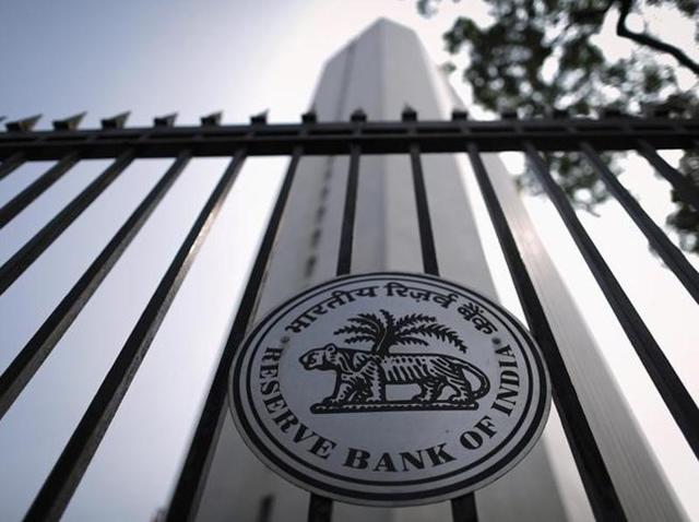 The Reserve Bank of India (RBI) seal is pictured on a gate outside the RBI headquarters. Indian banks are grappling with more than 110 billion dollars of corporate stressed debt, a burden that is holding back fresh loans and hampering a speedier economic recovery.