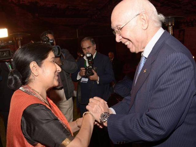 Pakistan Prime Minister's adviser on foreign affairs Sartaj Aziz (R) greets external affairs minister Sushma Swaraj in Islamabad. Swaraj arrived in Pakistan to attend the two-day 'Heart of Asia' conference, the highest-level visit from Delhi in years.