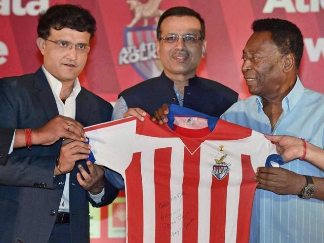 Former Indian cricketer Sourav Ganguly and Owner of Atletico de Kolkata Sanjiv Goenka holding the jersey of team during a program in Kolkata on October 10, 2015.