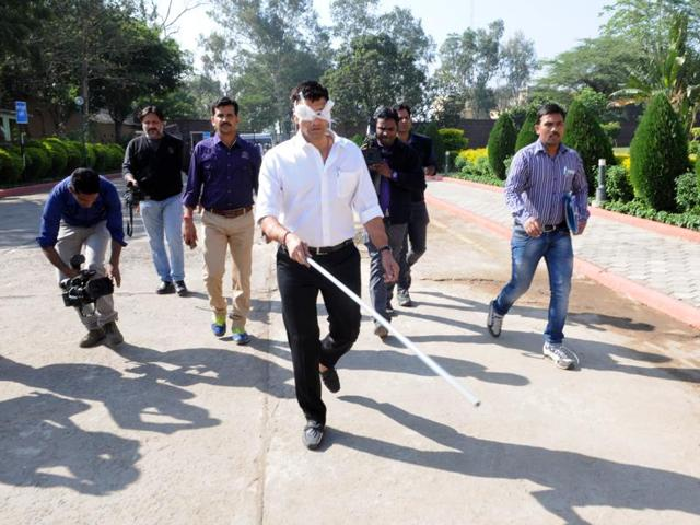 Congress MLA Jitu Patwari walks with bandaged eyes and a stick on assembly premises on Tuesday in a symbolic protest against the botched surgeries that cost 40 people their sight.