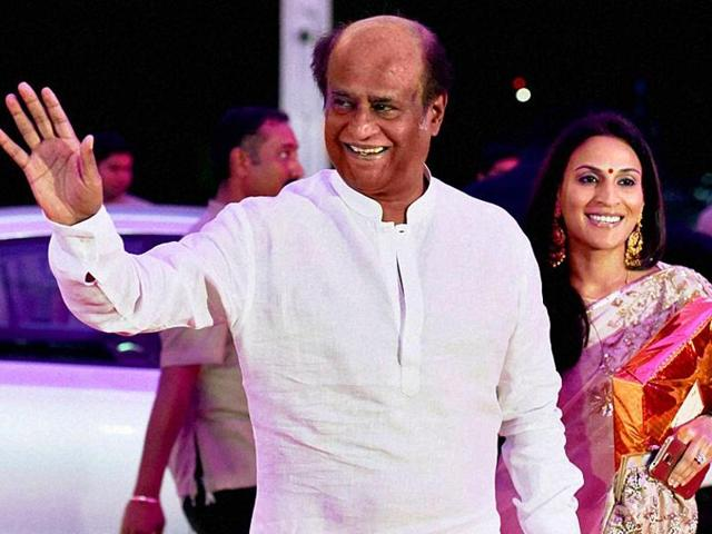 Rajinikanth was criticised for contributing a meagre Rs 10 lakhs for the Chennai flood victims. Seen here, with his elder daughter Aishwarya, at the wedding reception of Shatrughan Sinha's son Kussh.