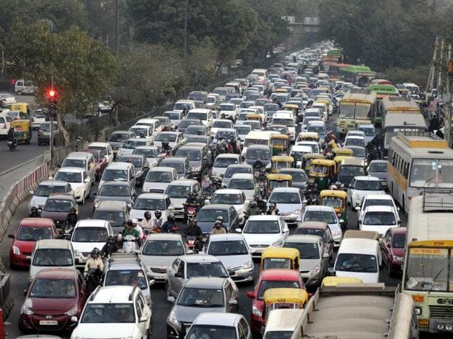 Vehicles moving at snail's pace due to a traffic jam at Ashram Chowk in New Delhi.