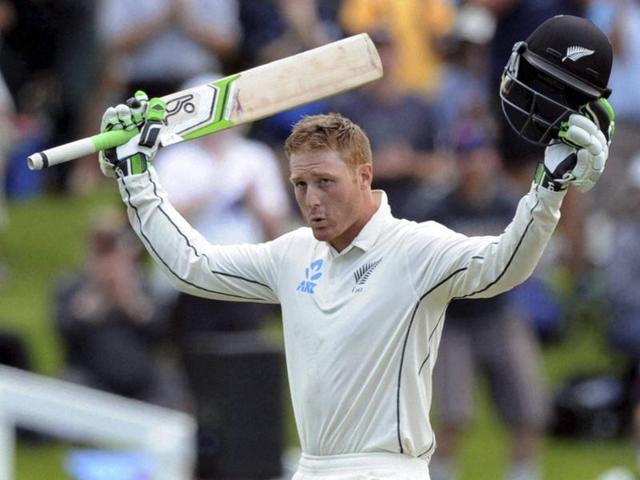 New Zealand's Martin Guptill celebrates his century against Sri Lanka on day one of the first international cricket test in Dunedinon December 10, 2015.