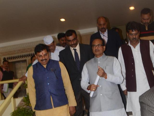Chief minister Shivraj Singh Chouhan and some party MLAs coming out of the  House during the  Assembly winter session in Bhopal  on Thursday.