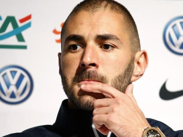 France's national football team player Karim Benzema attends a news conference in Clairefontaine, near Paris. Benzema has been indefinitely banned from the national football team for his involvement in the sex-tape case