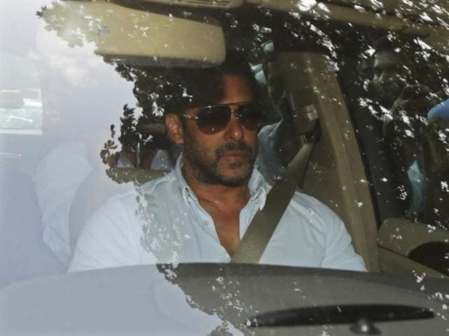 Bollywood actor Salman Khan arrives in a car at a sessions court in Mumbai.