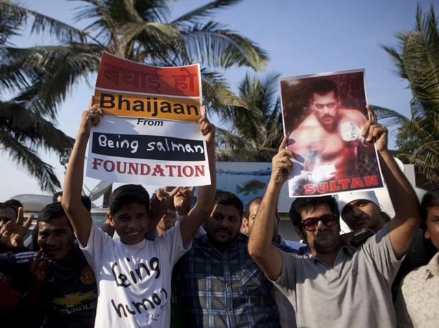 Fans gather outside Salman Khan's Bandra residence to get a glimpse of the Bollywood actor who was acquitted in the hit-and-run case on Thursday, in Mumbai.