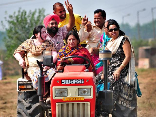 Mayor Poonam Sharma driving a tractor during a cleanliness drive at Maloya village; (right) slapping a drunk man for abusing her in Manimajra.