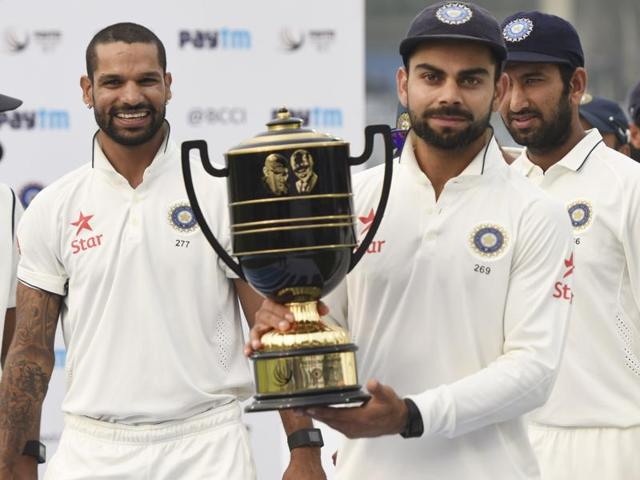 Virat Kohli poses with the trophy after winning the Test series against South Africa.