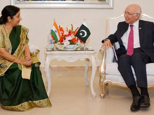 Indian Foreign Minister Sushma Swaraj shakes hand with Pakistani Prime Minister's adviser for Foreign Affairs Sartaj Aziz, right, prior to their meeting in Islamabad, Pakistan, Wednesday, Dec. 9, 2015. Swaraj told a news conference that India and Pakistan had agreed to resume talks, which have been on hold since August when Aziz suspended his visit to India over the issue of Kashmir.