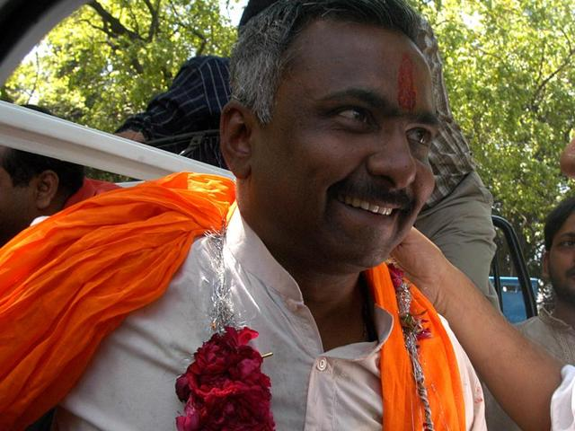 BJP leader Sanjay Joshi is greeted by party workers, in New Delhi. Joshi has emerged as the new 'poster boy' of the BJP in Gujarat.