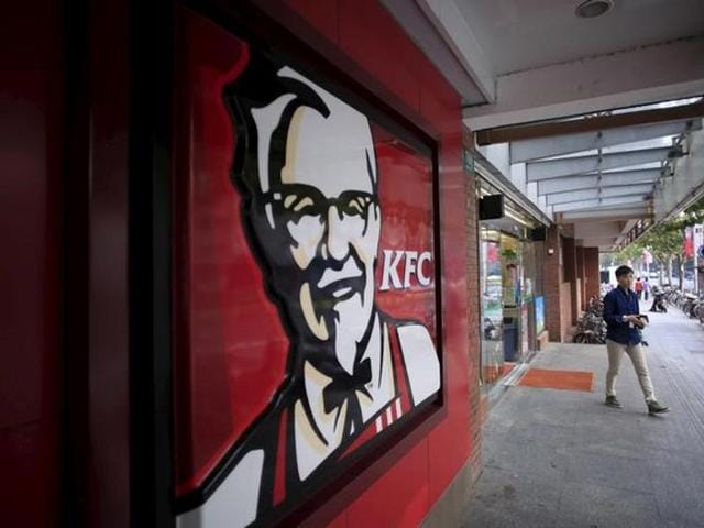 A customer walks out of a KFC restaurant in Shanghai, China. (Reuters)