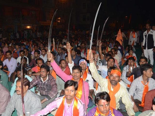 VHP workers brandish swords during a meeting held by Praveen Togadia to mark 'Shourya Diwas' in Bhopal on Sunday.