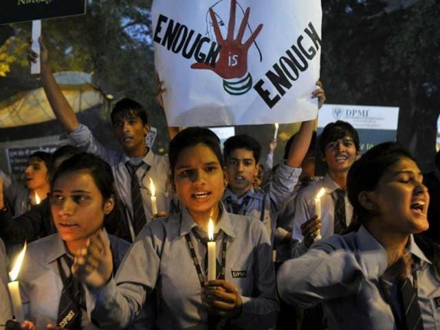 Students take part in a candle light vigil at Jantar Mantar, New-Delhi to commemorate the December 16 gang-rape. (HT Photo/Mohd Zakir)