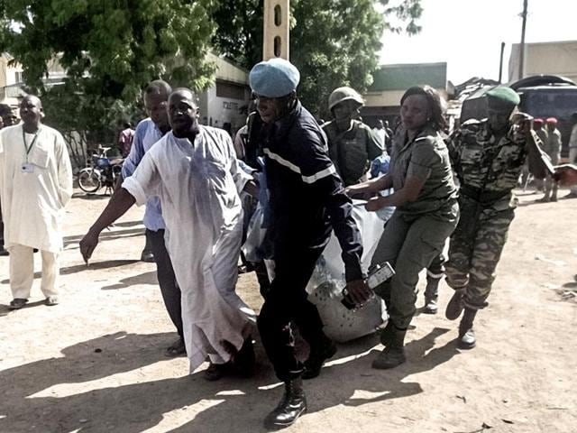 Security forces transporting the remains of victims of a double blast after two girls blew themselves in twin attacks in a region repeatedly targeted by Nigeria-based Boko Haram.  At least seven civilians were killed on Friday in a suicide attack in Kolofata.