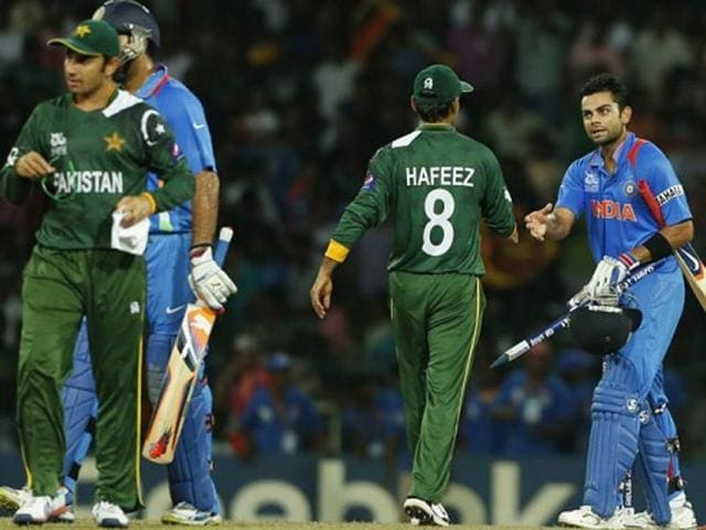 A file photo of India's Virat Kohli shaking hands with Pakistan's Mohammad Hafeez after their match.