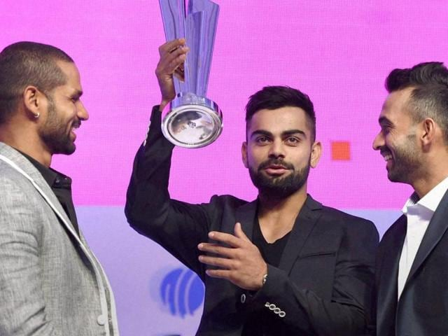 Cricketers Virat Kohli, Ajinkya Rahane and Shikhar Dhawan participate in a panel discussion during an ICC World Twenty20 2016 schedule announcement event in Mumbai on Friday. India will host the sixth Twenty20 World Cup in March and April of 2016.(AP)