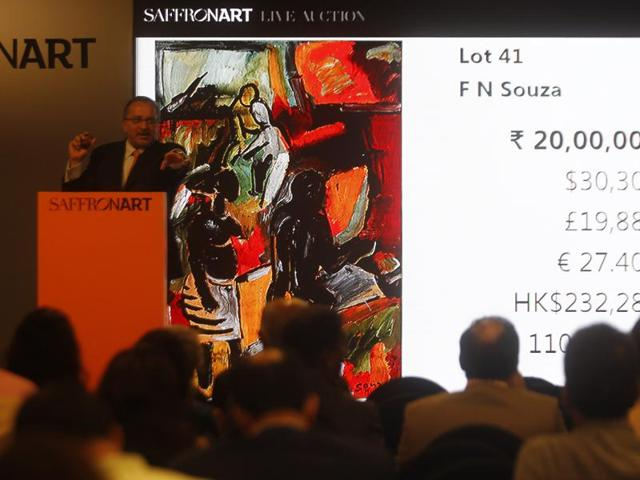 Dinesh Vazirani, co-founder of Saffronart, during the auction of artist FN Souza's works at Saffronart's new studio in Prabhadevi on Thursday.(Kunal Patil/HT photo)