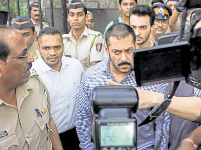 Bollywood star Salman Khan makes his way out of the Bombay high court after he was acquitted of all charges in the 2002 hit and run case, in Mumbai on Thursday.