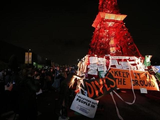 People demonstrate in front of a replica of the Eiffel Tower at the World Climate Change Conference 2015 (COP21) at Le Bourget, near Paris, France, December 9, 2015.
