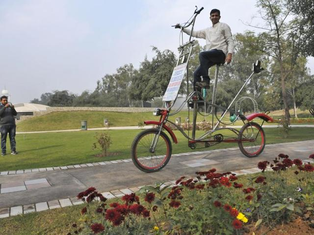 A man riding a unique bicycle bearing the UT administration's logo during the inauguration of the Garden of Springs in Sector 53, Chandigarh, on Thursday.