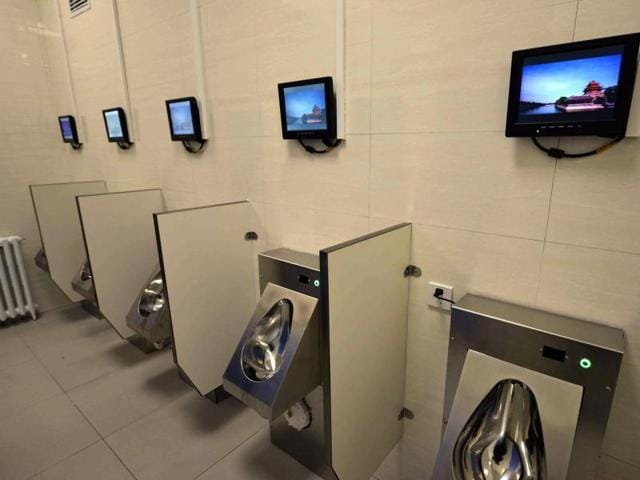 This picture taken on November 19, 2015 shows the first public toilet equipped with Wi-Fi, a bank ATM machine and chargers for mobile phones and electric vehicles in Beijing.