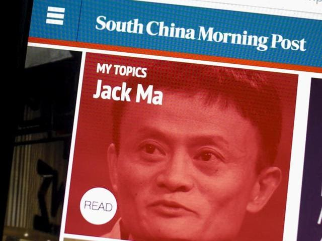 The South China Morning Post website and an image of Jack Ma, founder and executive chairman of Alibaba Group Holding, are displayed on a computer in Hong Kong, China. The Chinese e-commerce giant said it would buy publisher SCMP Group Ltd's media assets.