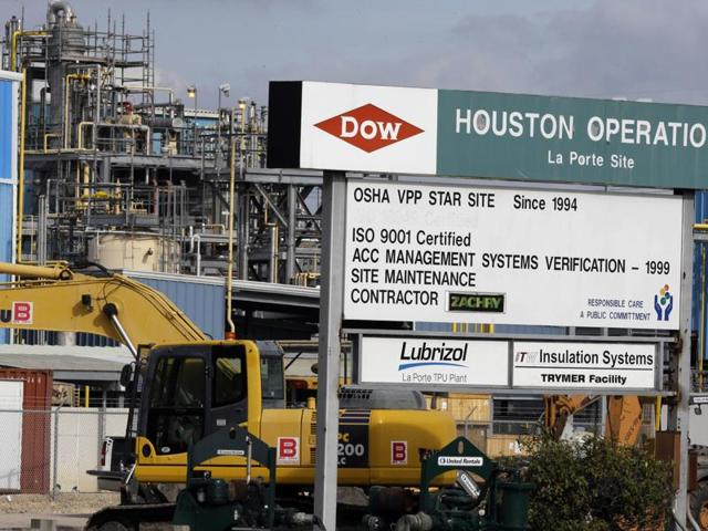 A file photo shows a Dow Chemical plant in La Porte, Texas. Dow Chemical and the DuPont will attempt to merge in an all-stock deal that would create a colossal chemical producer worth $130 billion.